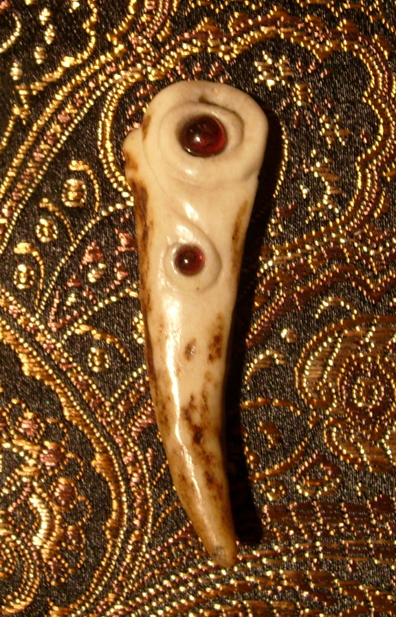 carved antler with garnet
